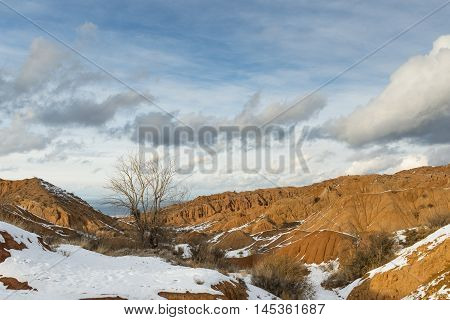 Orange hills in the snow Kyrgyzstan witer