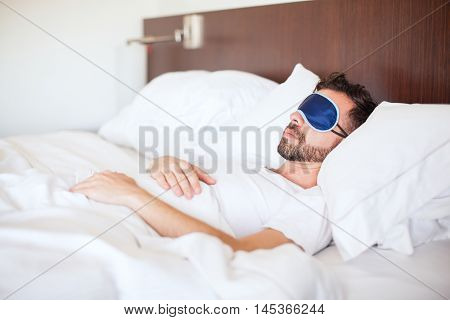 Man Wearing Sleep Mask In A Hotel