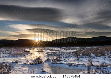 Dramatic Sky at Sunrise over Frozen Landscape