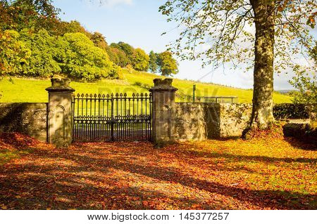 Old beautiful iron gate at the old Scottish church in Autumn