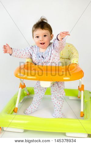 Baby Girl In A Walker