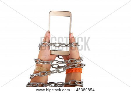Chained hands of a child holding a smartphone with white screen. Smartphone Internet addiction concept. Studio isolated on white background.