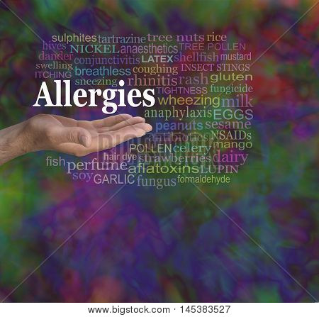 Allergies Word Cloud - male hand palm facing up with the word ALLERGIES floating above surrounded by a word cloud on a modern random multicolored background with copy space below
