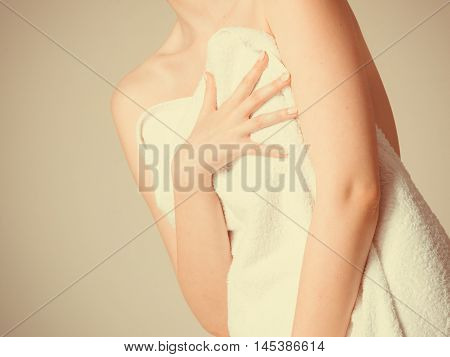 Shame and fear. Part body woman shamed of her nudity covering her breast with big bath towel. Innocence of female.