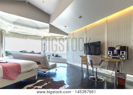 Modern style of living room with bed and sea view in resort Thailand