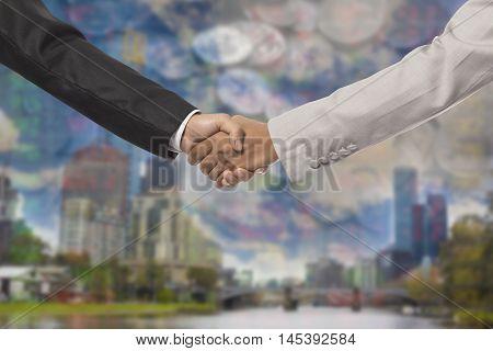 Handshake Of Businessmen On Blur Business Background