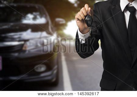 Businessman Showing A Car Key - Car Sale & Rental Business Concept
