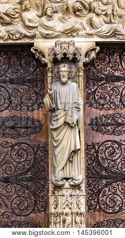 PARIS, FRANCE -  MAY 31, 2015 Judgement Door Biblical Statues Notre Dame Cathedral Paris France. Notre Dame was built between 1163 and 1250AD.