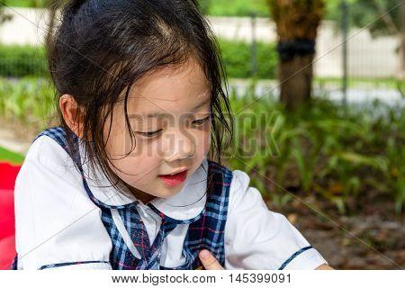 Child Playing Sand At Playground, Head Shot