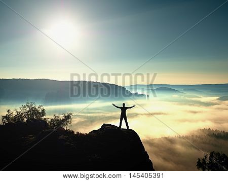 Happy Man Gesture Of Triumph With Hands In The Air. Funny Hiker With Raised Arm