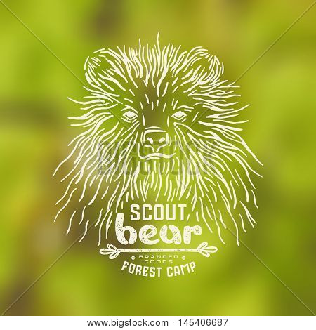Stock vector linocut with a picture of bear. Graphic design for t-shirt. White print on blurred background