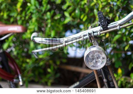 Detail of a Vintage Bicycle Handlebar Resting at park