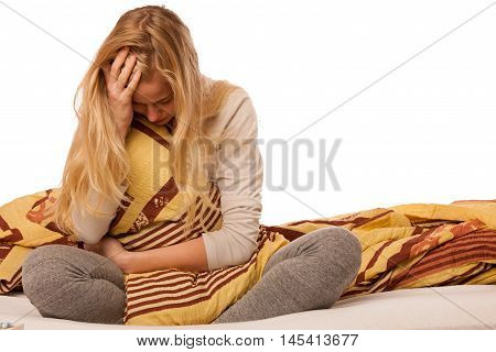 Woman Sitting On Bed Holding Belly Because Of The Pain In Stomac.