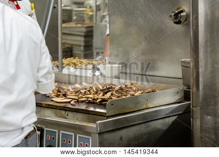 Chicken Cooking on an industrial Kitchen Griddle