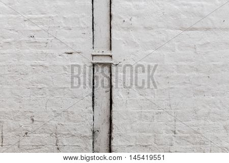 White Painted Brick Wall With Downpipe