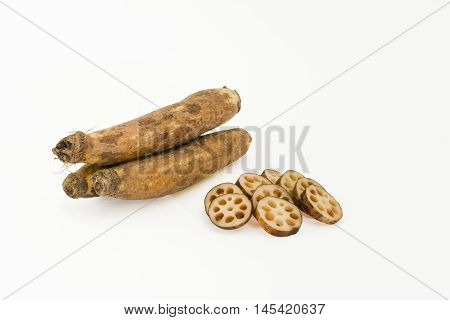 Lotus root - whole and chopped - on a white background
