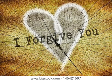 Text I Forgive You written over drawn broken heart