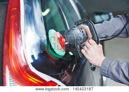 auto mechanic buffing car autobody