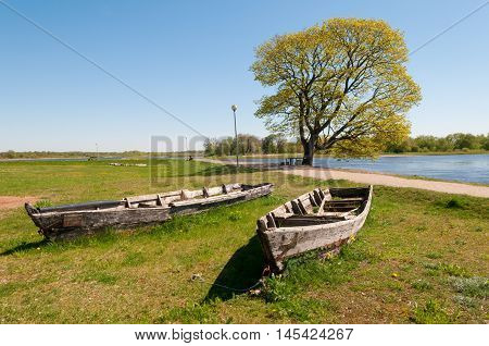 Two old boats at the Nemunas river Rusne island Lithuania