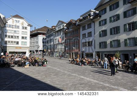 LUCERNE SWITZERLAND - MAY 04 2016: Muehlenplatz famous because of the history of old city mills however they have been destroyed by fire in 1875 nowadays it is a place eagerly visited by tourists