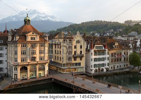 LUCERNE SWITZERLAND - MAY 02 2016: Townhouses down by the river Reuss shows the unique character of the city and variety of sightseeing attractions. The town is a destination for many travelers