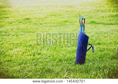 quiver of arrows outdoors. leather tube quiver arrow. empty space for your text