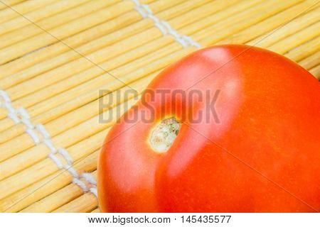 Close-up of freshripe tomat on wood background