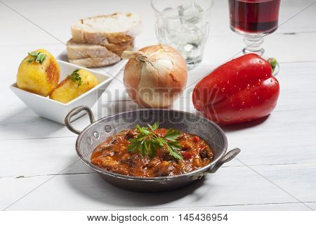 hungarian goulash in a pot with wine