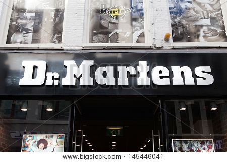 Amsterdam, The Netherlands, August 30, 2016: Dr.Martens logo and store front. Dr. Martens is a British footwear and clothing brand, which also makes a range of accessories.