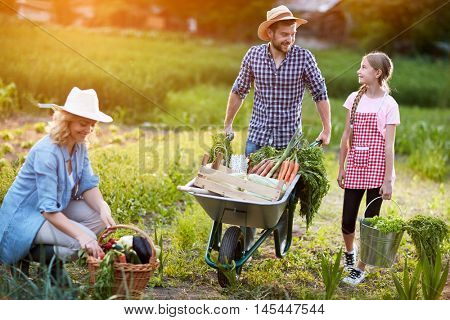 Diligent farmers family in garden