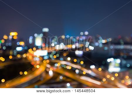 Blurred lights night view city and highway interchanged at twilight, abstract background