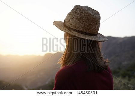 Girl From Behind Looking At The Mountains