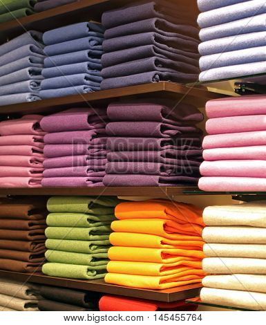 Colorful Cashmere Wool Jumpers Folded in Shelf