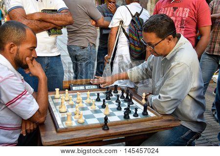 SANTO DOMINGO, DOMINICAN REPUBLIC - January 24: Street life, men playing chess on Calle el Conde, Colonial Zone. Taken in January 24, 2016 in Santo Domingo, Dominican Republic.