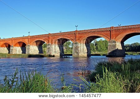 Old brick bridge across Venta river in Kuldiga Latvia is one of the longest bridges of this type in Europe. Built in 1874.