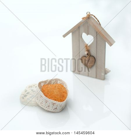 Cake in a casket in the form of heart on a white background scenery around the house