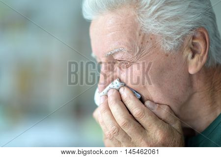sad beautiful old man is sick in the room
