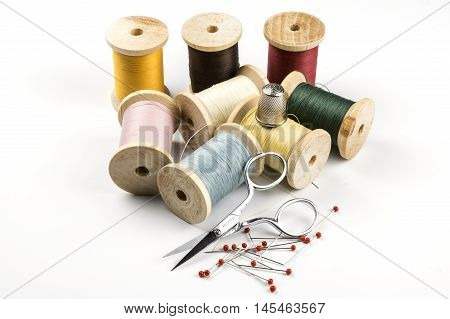 Thread spools, thimble, some Pins and a scissor