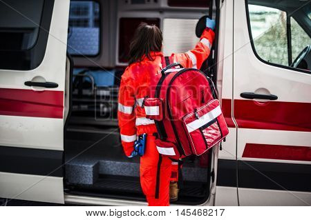 operator with emergency rucksack in an ambulance