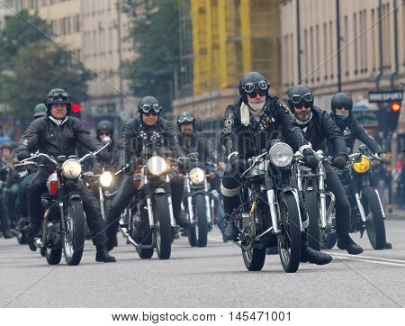 STOCKHOLM SWEDEN - SEPT 03 2016: Group of bikers on old fashioned motorcycles at the Mods vs Rockers event at the Saint Eriks bridge Stockholm Sweden September 03 2016