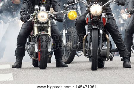 STOCKHOLM SWEDEN - SEPT 03 2016: GCloseup of old fashioned motorcycles and bikers at the Mods vs Rockers event at the Saint Eriks bridge Stockholm Sweden September 02 2016