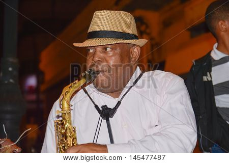 SANTO DOMINGO, DOMINICAN REPUBLIC - January 24, 2016: Street artist with saxophone in Calle el Conde, Santo Domingo, Dominican Republic.