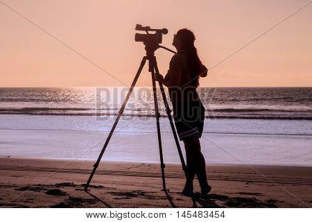 Woman Photographer Takes Photo Of The Beautiful Seascape Galapagos Island Ecuador South America