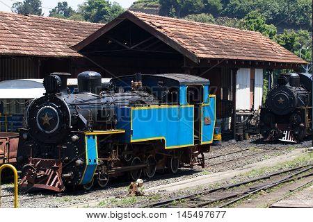 OOTY, TAMIL NADU, INDIA, 22 March 2015 : Nilgiri mountain railway. Blue train. Unesco world heritage. Narrow-gauge. Steam locomotive in depot
