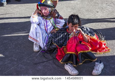 Píllaro ECUADOR - FEBRUARY 6 2016: Unidentified people wearing costumes and masks in diabladas of Pillaro