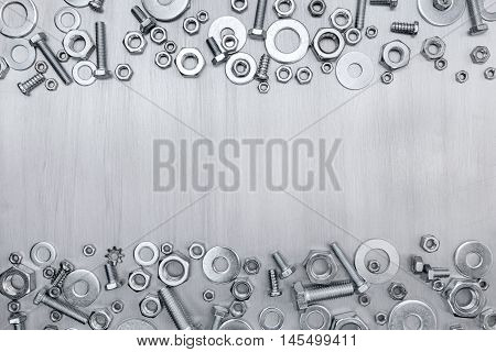 Set Of Chrome Screws And Bolts Of Different Size On Brushed Metal
