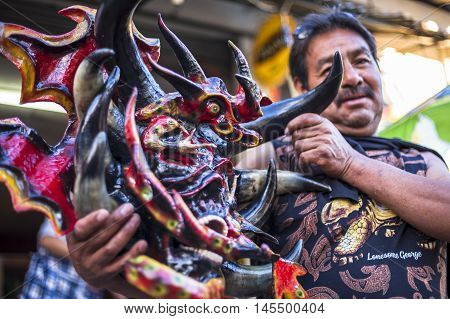 Píllaro ECUADOR - FEBRUARY 6 2016: Craftsman shows his diabolical mask to be used in the diabladas of Pillaro