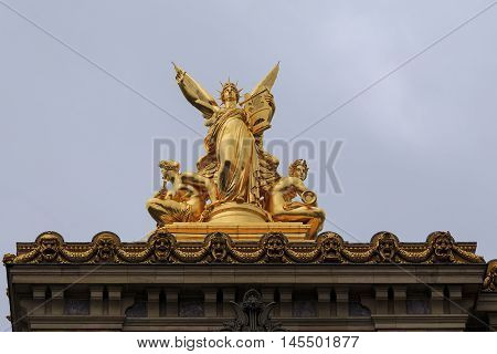 PARIS, FRANCE - MAY 15, 2015: This is fragment of the facade of the Grand Opera with a gilded figure of the muse Terpsichore.