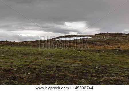 This is the Hardangervidda National Park in Norway in murky weather.