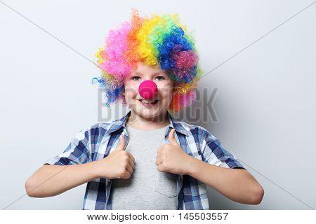 Portrait Of  Little Boy Clown On Grey Background